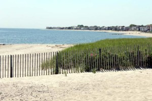 Rare beachfront property with summer cottage. $1,395,000